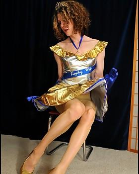crossdresser in shiny dress & pantyhose stuffs Obama dildo in her asspussy.