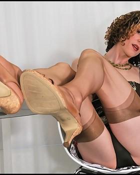 crossdresserl in tan stockings displays upskirts & her big laptop surprise.