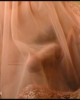 Sweet Delia's stiff clit under her sheer pink panties and nighty.